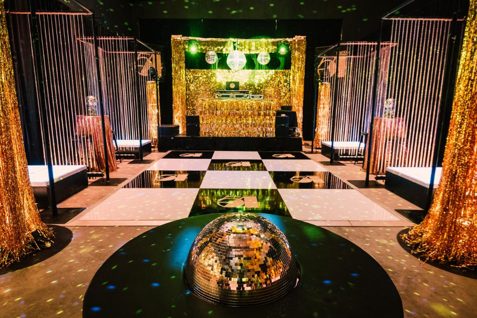 empty warehouse decorated and transformed into a studio 54 theme