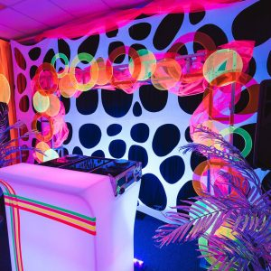DJ booth at neon themed event