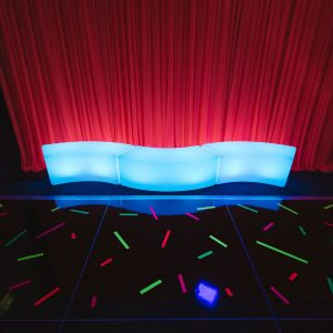 LED Curved Bench Hire Melbourne blue glow with red drape