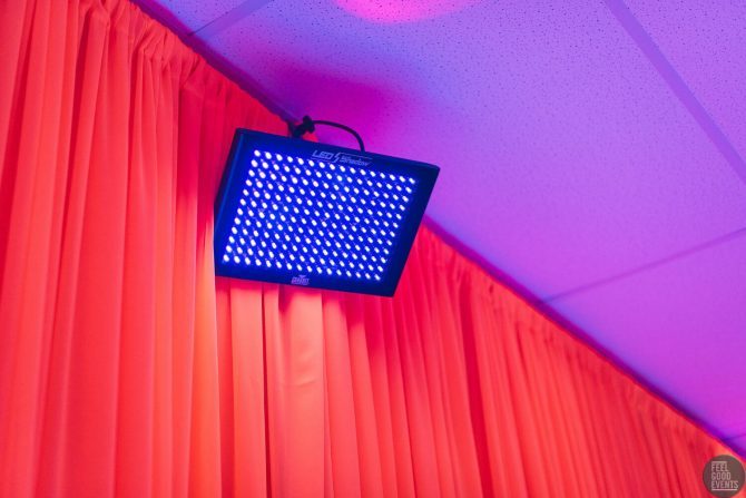 UV Light Hire Melbourne infront of Red Drape
