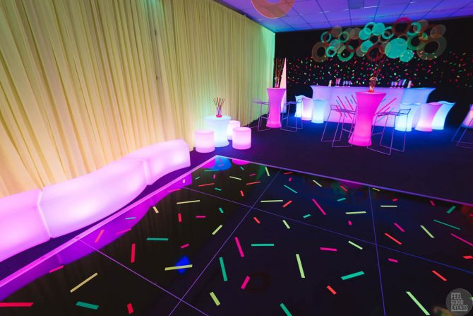 gold drape setup in colourful themed event hire melbourne