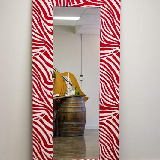 red and white coloured zebra print mirror