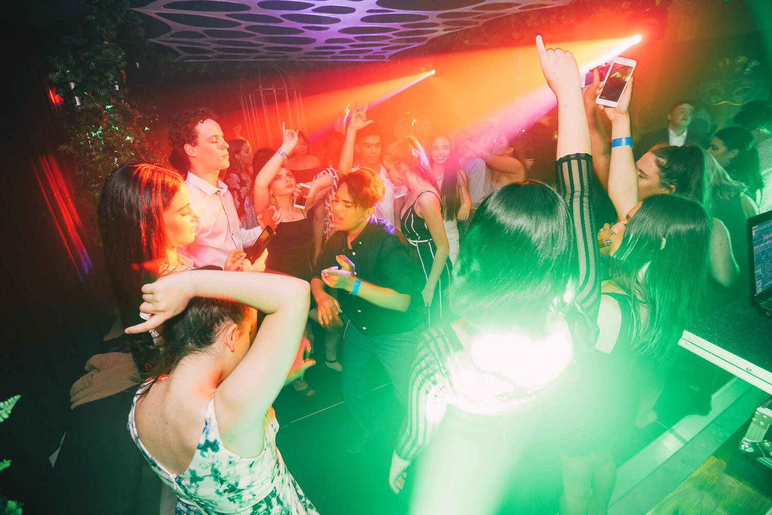 Red and Green lasers in a jungle party melbourne available for hire