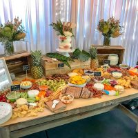 Rustic and tropical grazing table white drape backdrop hire melbourne