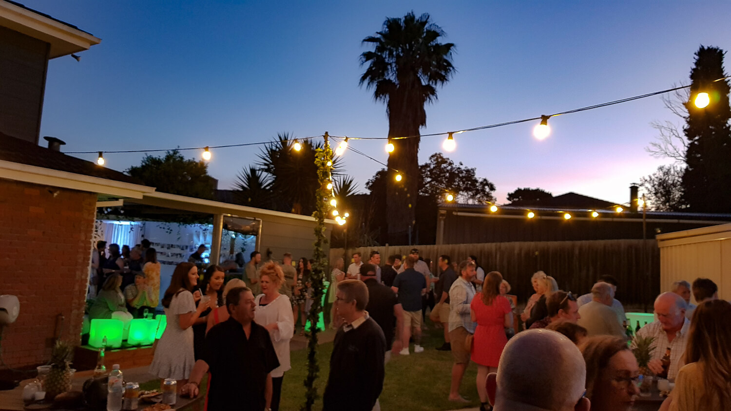 festoon light hire engagement party in backyard melbourne