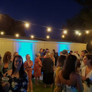 festoon lights and blue uplighting hire at backyard party melbourne