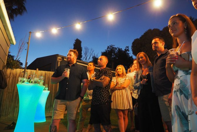 light up bar table and festoon lights hire at backyard event in melbourne
