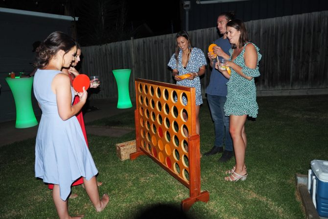 playing connect 4 at backyard party melbourne hire