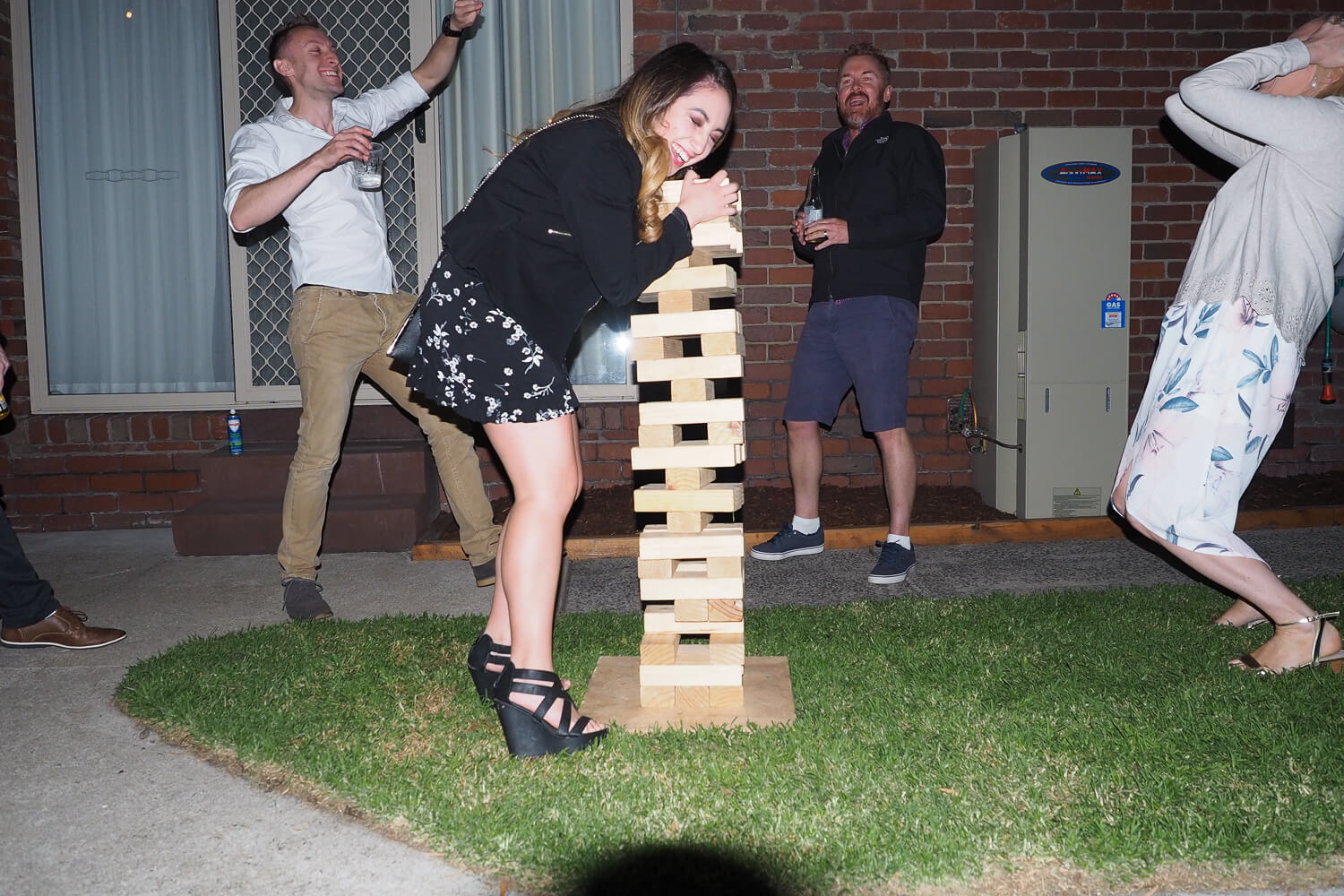 playing outdoor jenga at engagement party 2