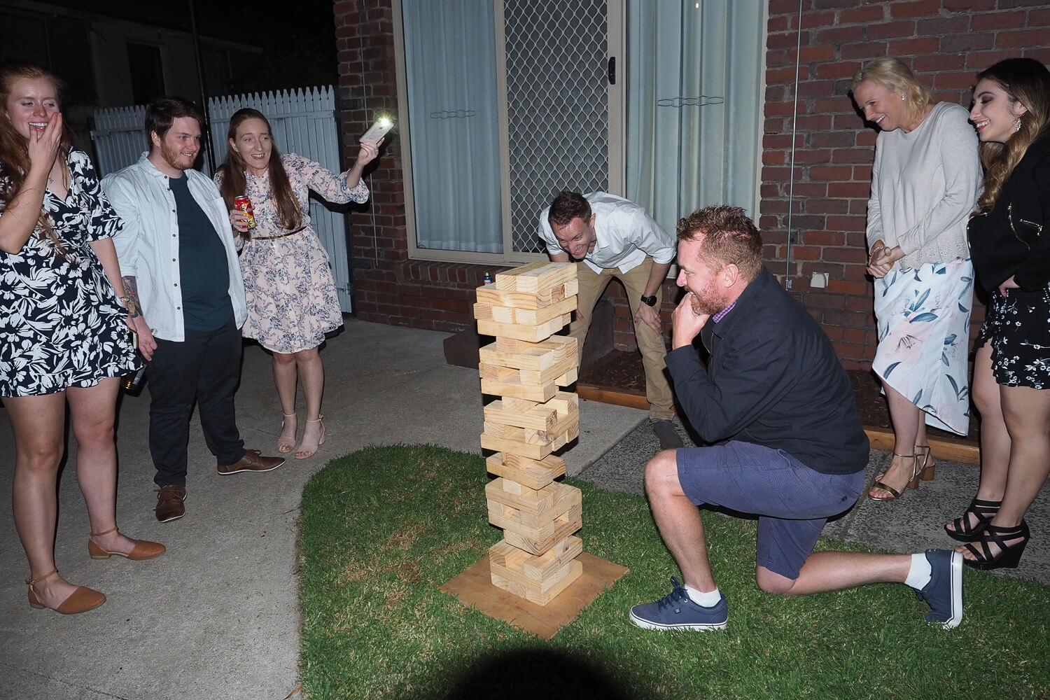 playing outdoor jenga at engagement party