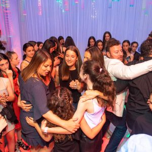 full dance floor with white draping in background during bat mitzvah