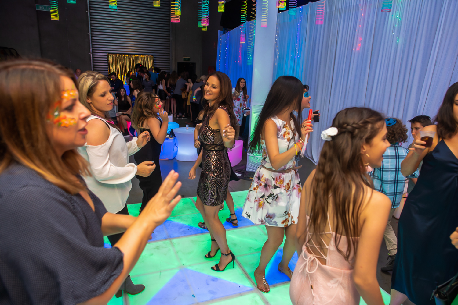 fun at a party with hired light up dance floor and furniture melbourne