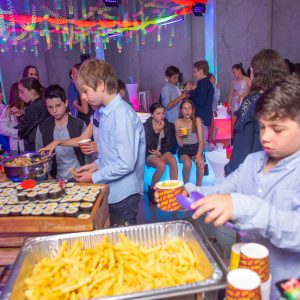 glow themed bat mitzvah food station with dance floor in background