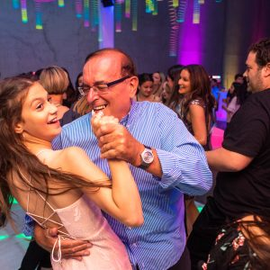 having fun during a bat mitzvah with uplighting hire in background melbourne