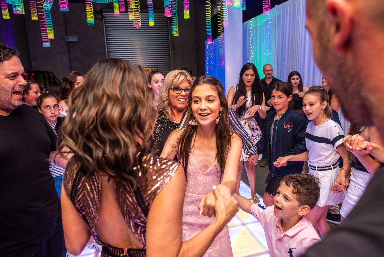 jennas bat mitzvah celebration with white draping and uplighting