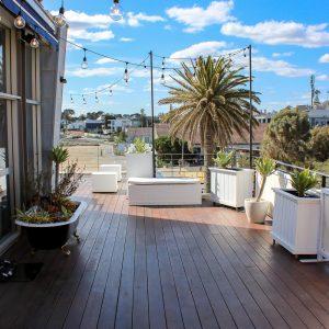 Vintage Festoon Light hire Melbourne Hanging over decking area