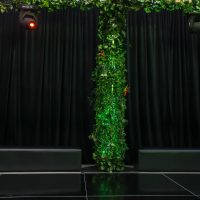 black drape with vine covered column on dance floor hire melbourne