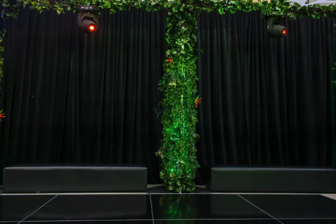 black drape with vine covered column on dance floor hire melbourne