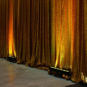 led strip light infront of gold sequin drape hire melbourne