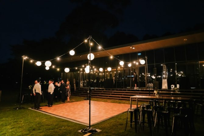 outdoor wedding dance floor with overhead festoon lanterns in melbourne