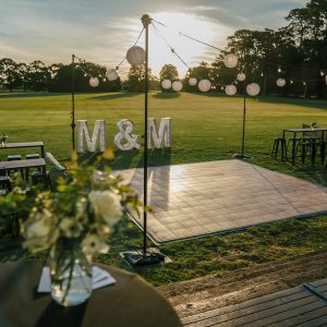 outdoor wedding hire in melbourne with dance floor and festoon lights feel good events