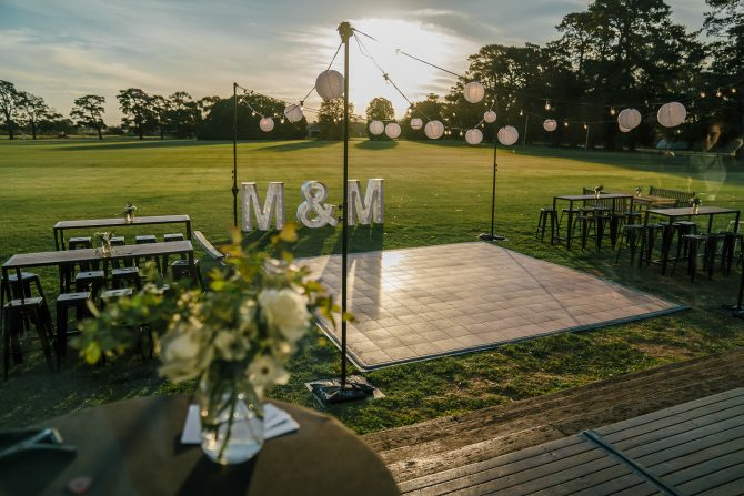 outdoor wedding hire in melbourne with dance floor and festoon lights feel good events