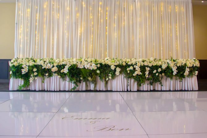 fairy_light_backdrop_with_white_dancefloor_and_bridal_table_hire_melbourne
