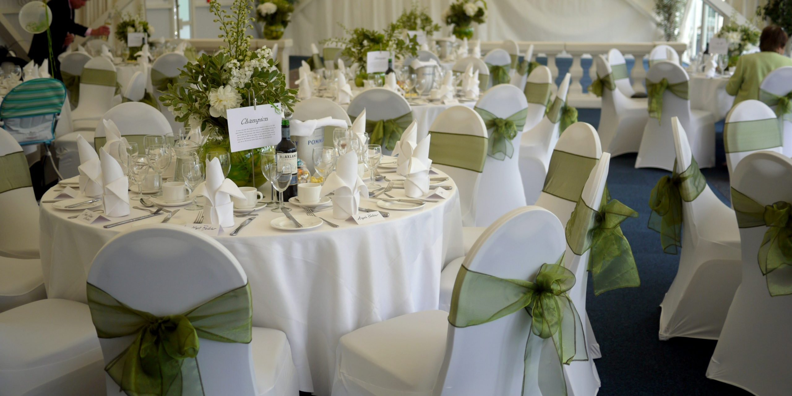 wedding marquee set up with green and white table setting